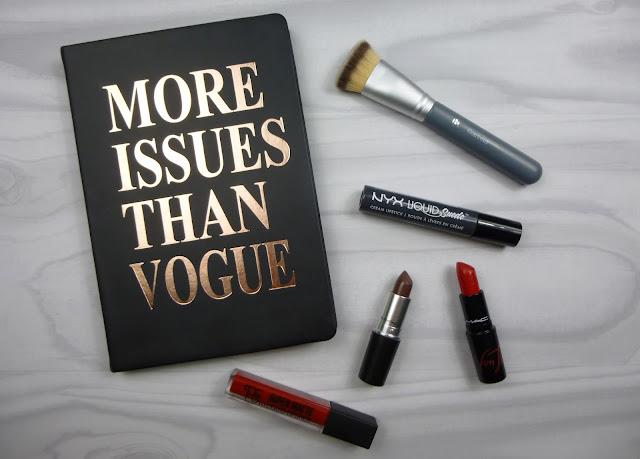 Various lipsticks for autumn on a white wooden background.