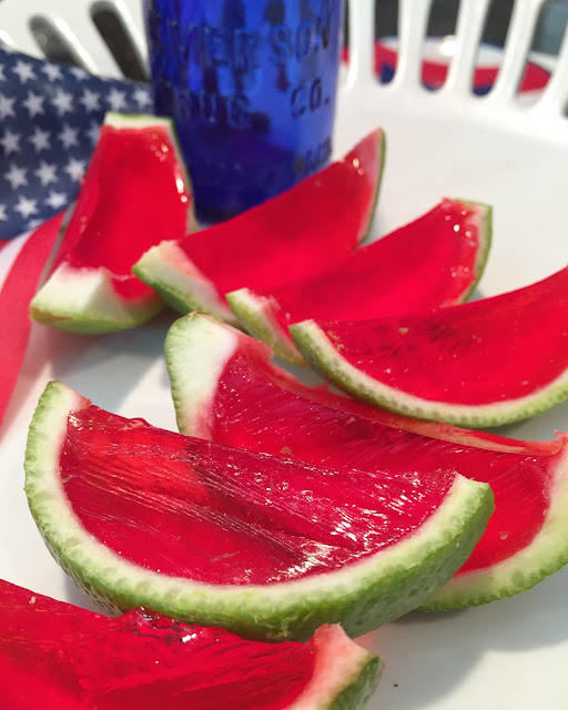 Sliced watermelon and sliced lime Jello shots