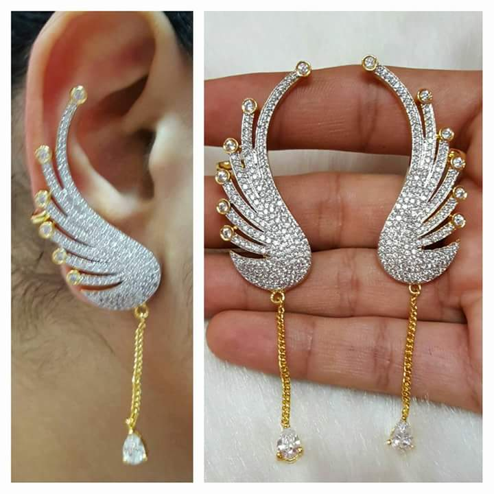LATEST DESIGNS GOLD JEWELLERY: LATEST PEACOCK DESIGNS FULLY WHITE ...