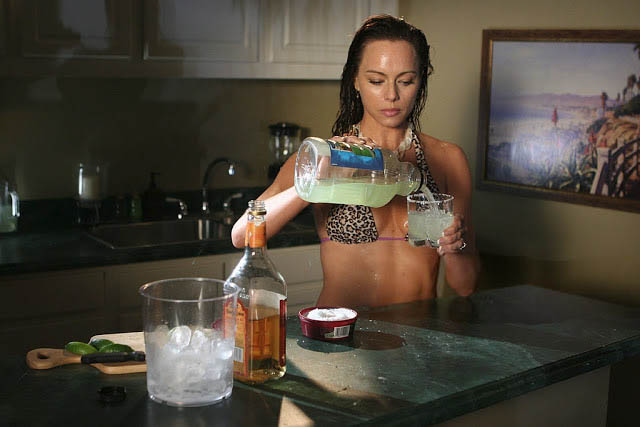 Julie pours drink for Caleb the o.c.