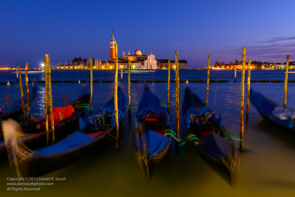 a photo of gondolas at dusk in venice italy