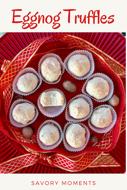 Platter of finished eggnog truffles with a ribbon and nutmeg decorating the platter.