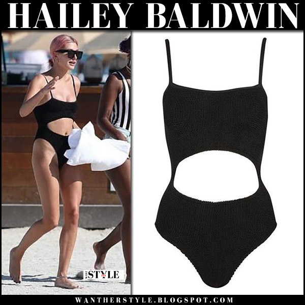 Hailey Baldwin in black cutout one piece swimsuit on the beach january 2017