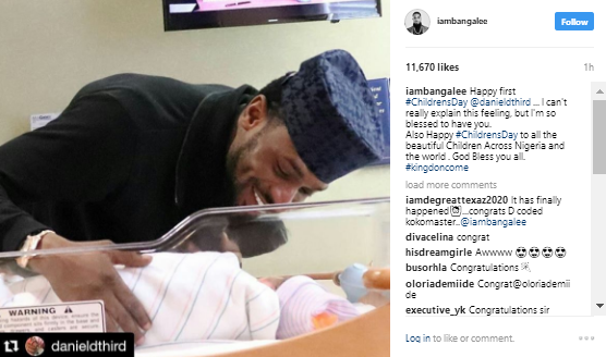 a - First photo of D'Banj smiling at his newborn son, Daniel