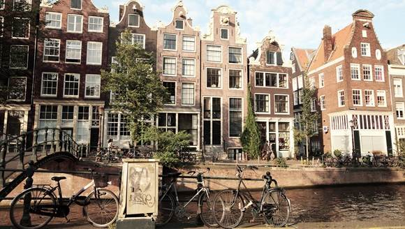 Photo of the canals, houses, bridge and bicycles of Amsterdam, Holland / Netherlands