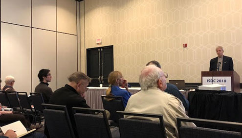Buzz Aldin of Apollo 11 lunar landing fame, at far left listens to technical session at ISDC 2018