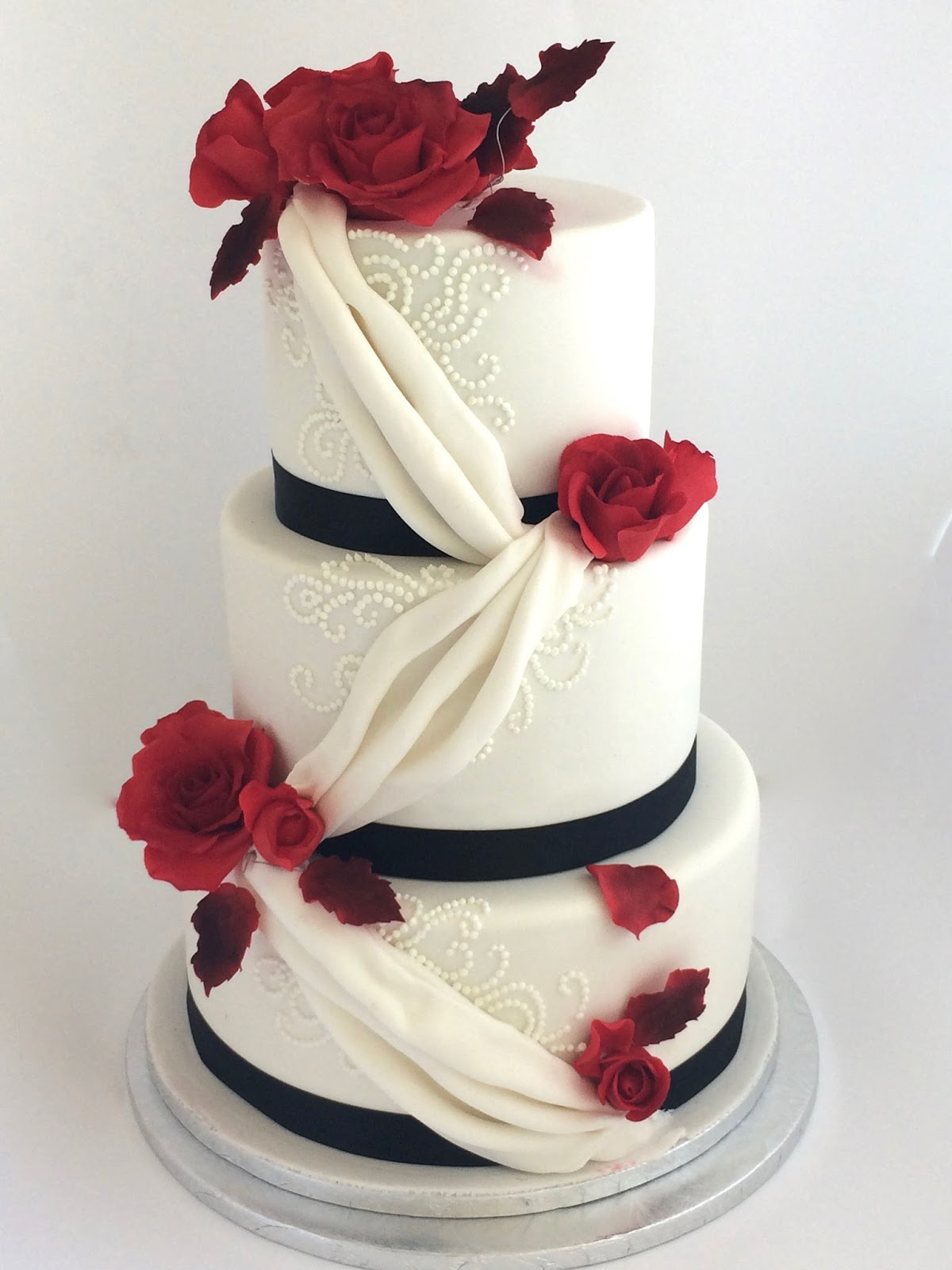 Rozanne s Cakes White fondant cake with red Sugar Roses