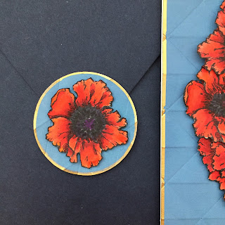 poppies envelope seal made from an extra red flower and blue background scraps. Memorial Day card.