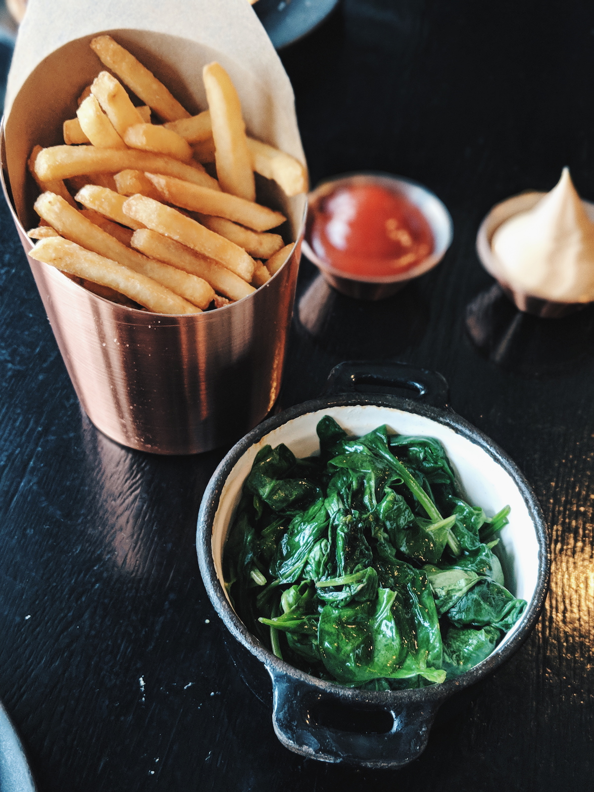 Spinach fried with shallot butter and fries.