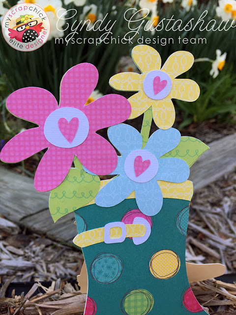 Close up of flowers coming out of the top of the Rainboot card