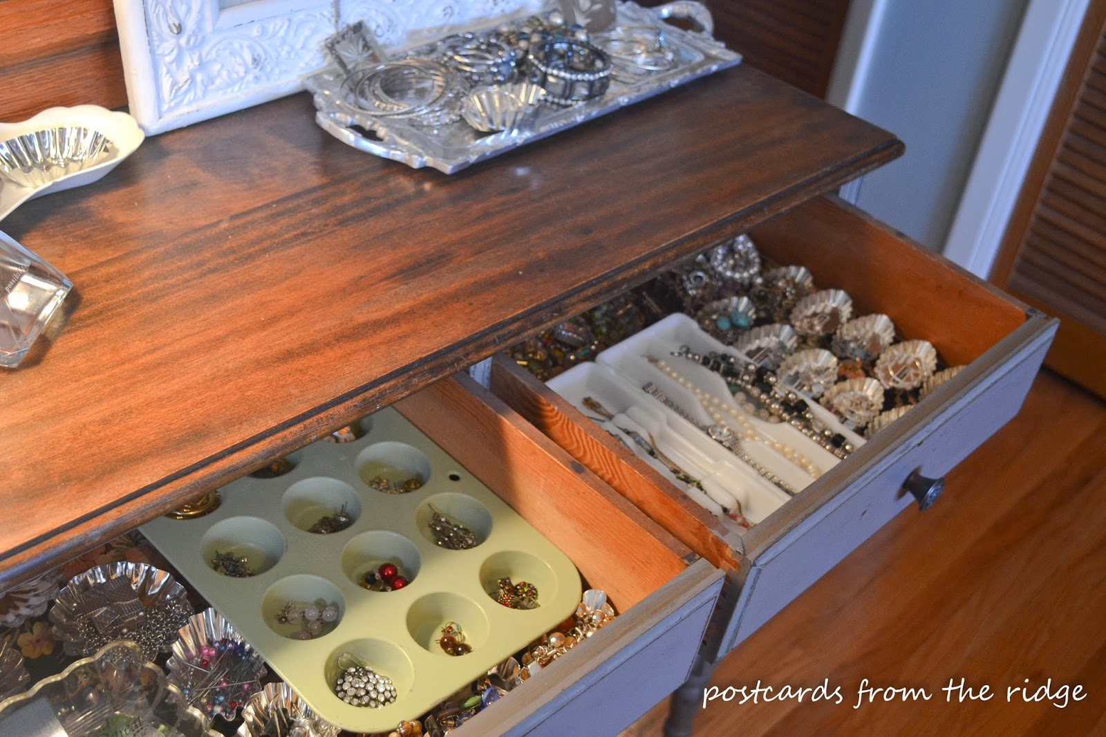 Vintage tart tins, muffin pans, and other items repurposed for jewelry organization.  Very clever!
