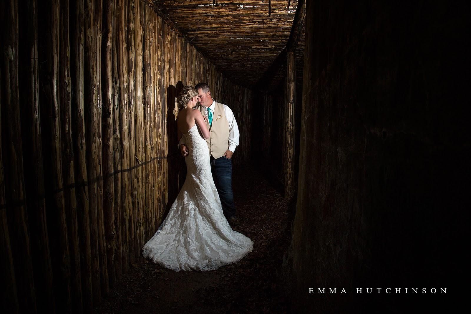 Newfoundland backyard wedding - Bride and groom in dark tunnel - cool light