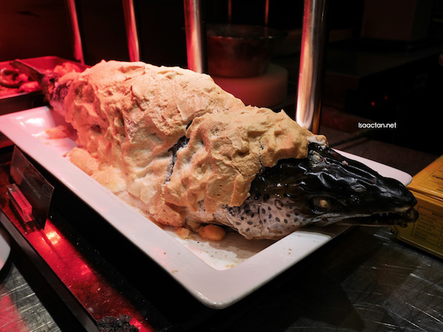 Now here's a huge fish, wrapped in salt