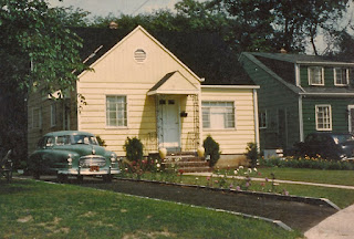 The Dixon home on Thompson Ave., Roselle, NJ. 1953. A little yellow house with flowers all around!
