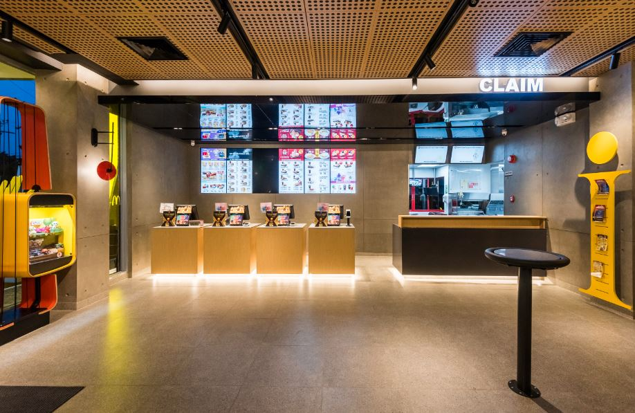Separate counter for ordering and claiming at McDonald's NXTGEN store.