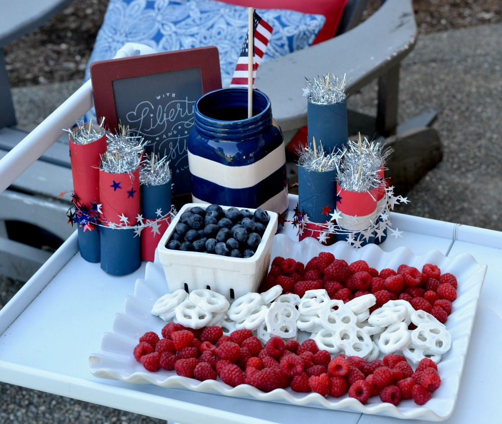 red, white and blue, raspberries, blueberries, pretzels