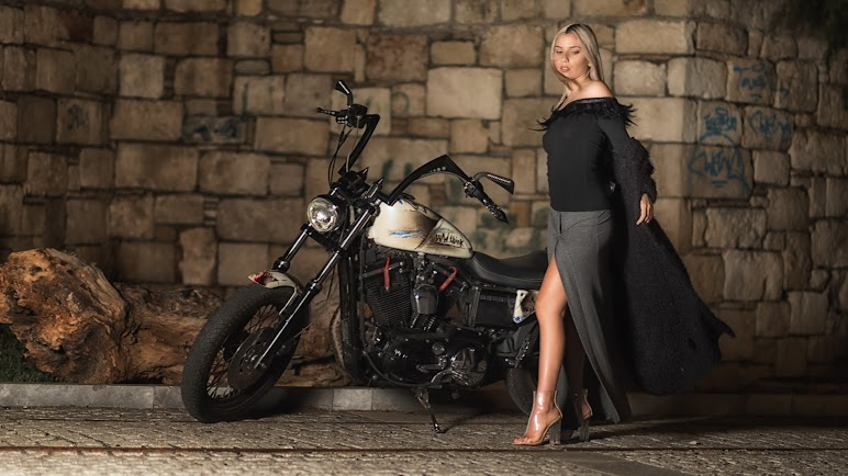 Woman In Black and Grey Long-sleeved Dress Standing Beside Cruiser Motorcycle