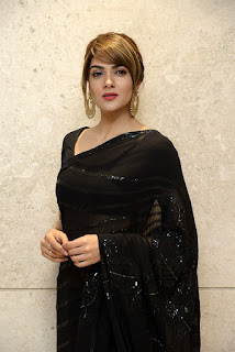 Sakshi Chaudhary Photos in Black Saree at Suvarna Sundari Movie Trailer Launch Event.