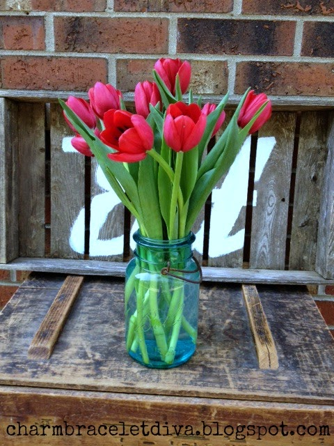 red tulips blue mason jar vase