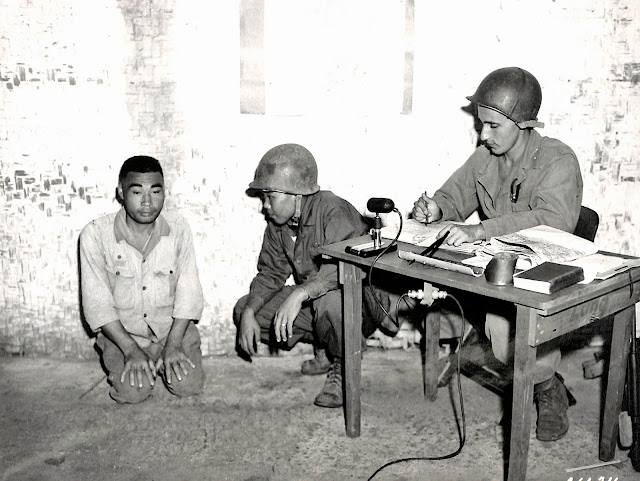 A Japanese prisoner is being interviewed by US Army Intelligence in Lipa, 1945.  Image source:  United States National Archives