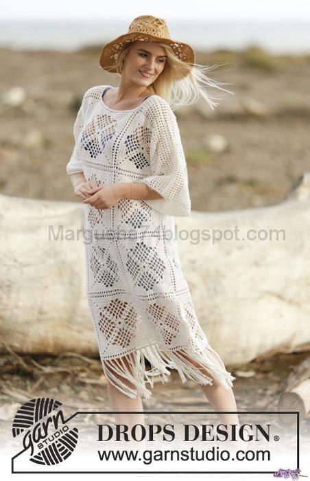 e7b511e6e3a Вязание крючком из квадратных мотивов. Белое ажурное платье с бахромой. Из  журнала