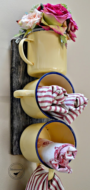 Yellow enamelware mugs filled with fabric napkins