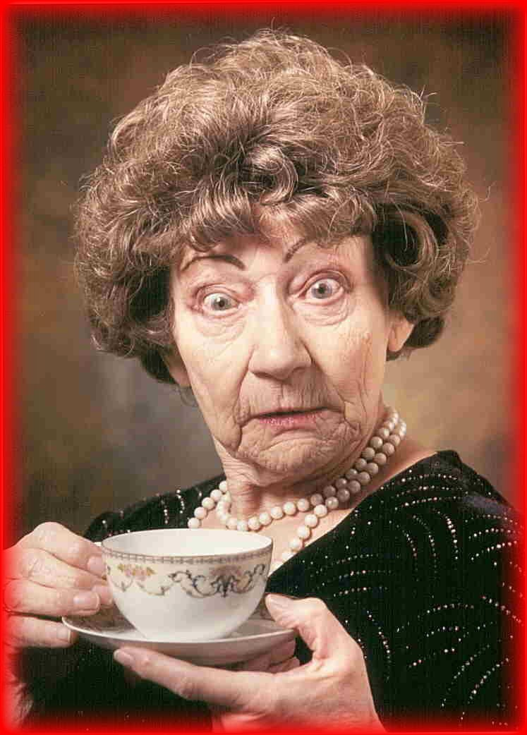 Shocked woman with a cup of tea