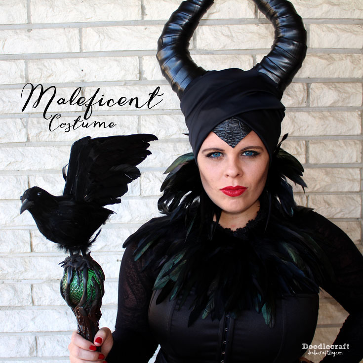 Handmade cosplay of Maleficent in black horns, feathers and staff.
