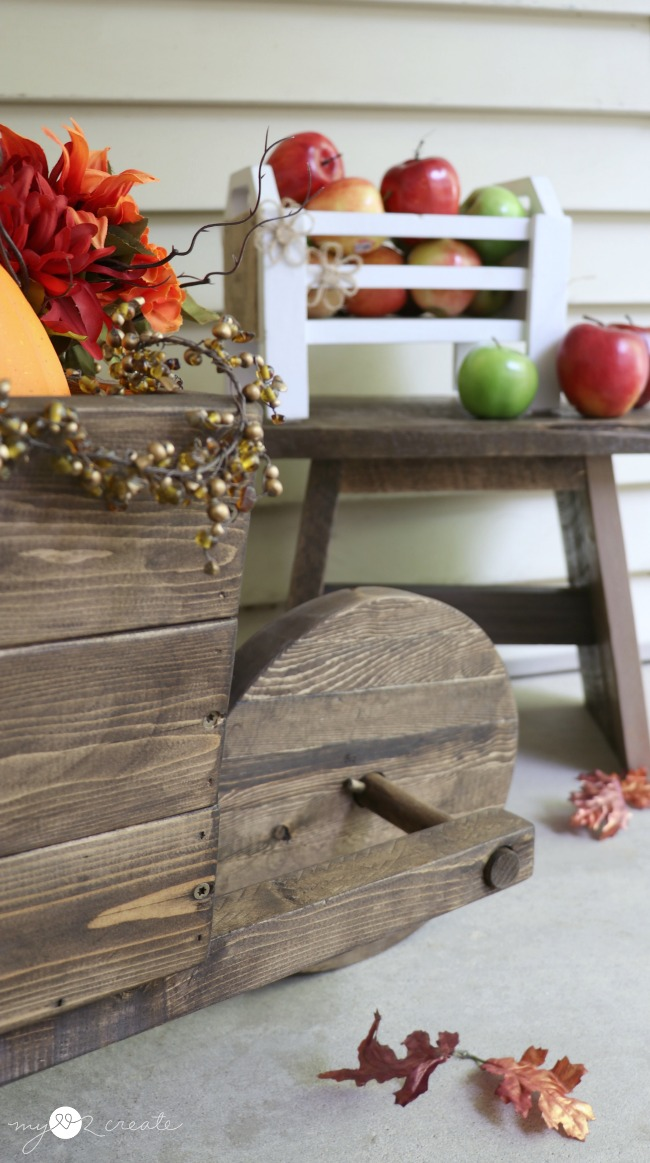 How to Make a Rustic Wheelbarrow with a full picture tutorial at MyLove2Create