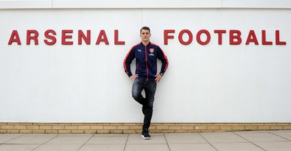 Granit Xhaka posing by Arsenal's training ground