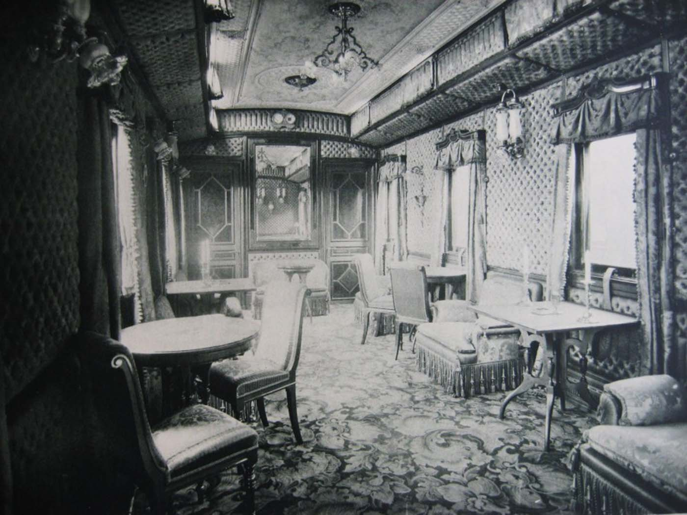 The saloon had soft mahogany furniture in the Art Nouveau style. The walls, sofas, armchairs and chairs were lined in striped pistachio curtains; a plush carpet on the floor had a checked design.