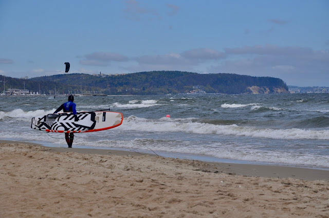 Paddleboarder on polish beach