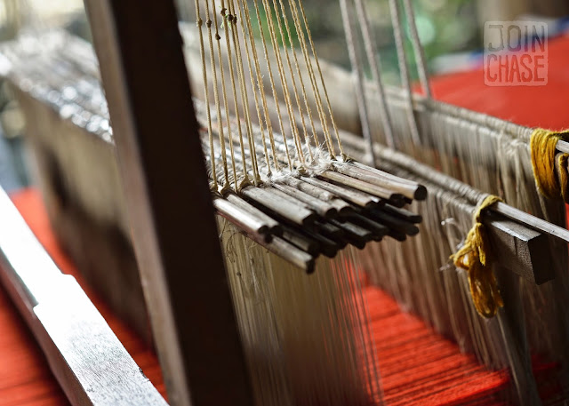 Close up of the loom and red thread used to make the tablecloth for the Coca-Cola commercial in Sagaing Division, Myanmar.