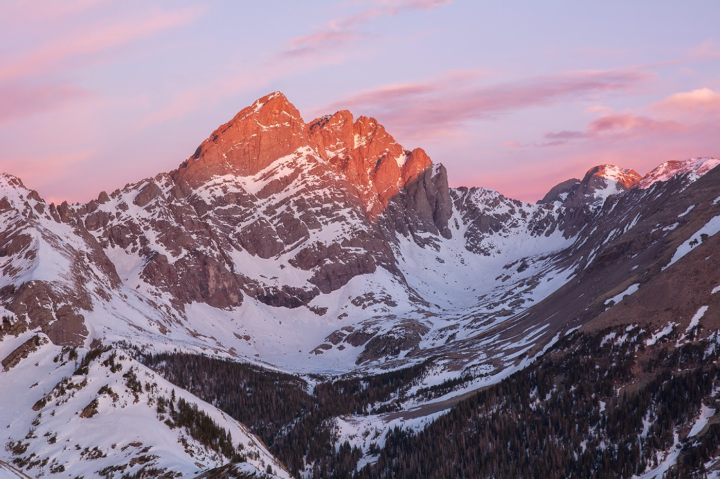 The Crestone Peak and Needle at sunrise from Marble Mountain in early Spring photography by Aaron Spong