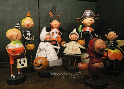 This photo features an array of whimsical figurines depicting  trick or treaters