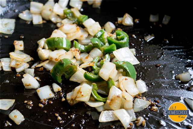 cook onion, garlic and serrano chili in coconut oil