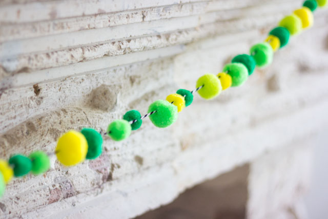 Make a simple pom-pom garland by stringing them onto baker's twine!