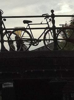 Bike-cycling-Amsterdam-bridge-canal-silhouette