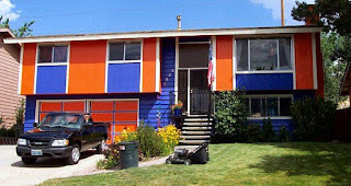 An image of a house with blue coloured in combination with orange