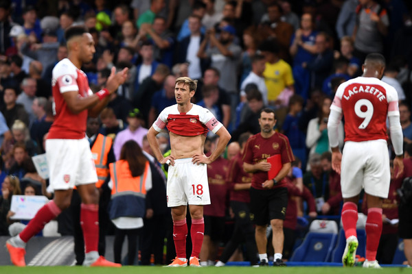 Arsenal players Aubameyang, Monreal, Lacazette sad after 3-2 loss at Chelsea in a Premier League match on August 18, 2018