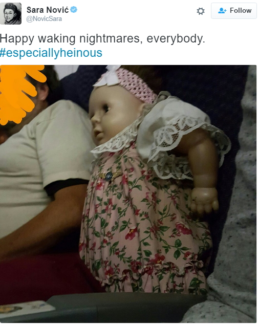 man buys flight ticket baby doll