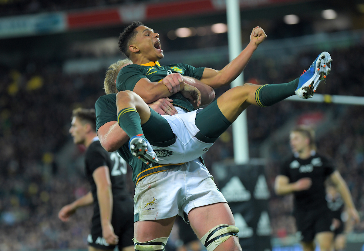 South Africa's Pieter-Steph du Toit congratulates South Africa's Herschel Jantjies on his last minute try during the Rugby Championship