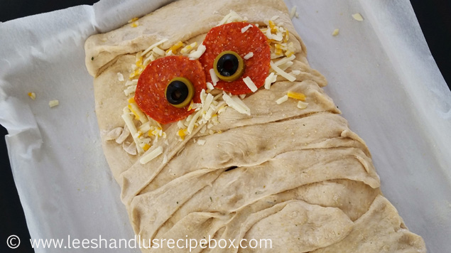 Mummified Stromboli - fun Halloween dinner idea that everyone will enjoy!
