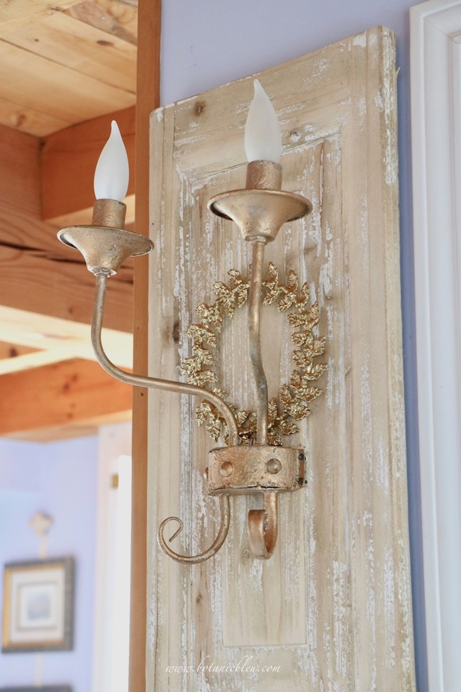 French wood panel sconce after makeover