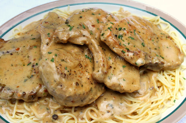 My take on the popular Crockpot Angel Chicken that's going around the internet, made with Italian dressing mix and cream cheese, except using pork chops, a homemade cream sauce, and cooked on the stovetop.