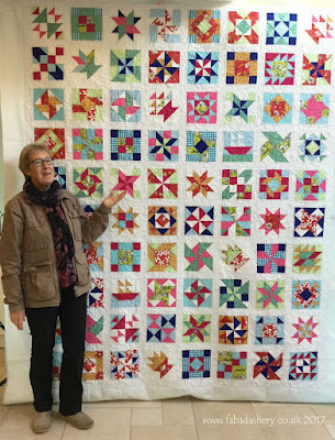 Lynne with her Homestead Sampler Quilt art of quilting magazine