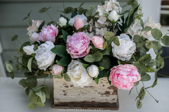 Peony arrangement in white painted box