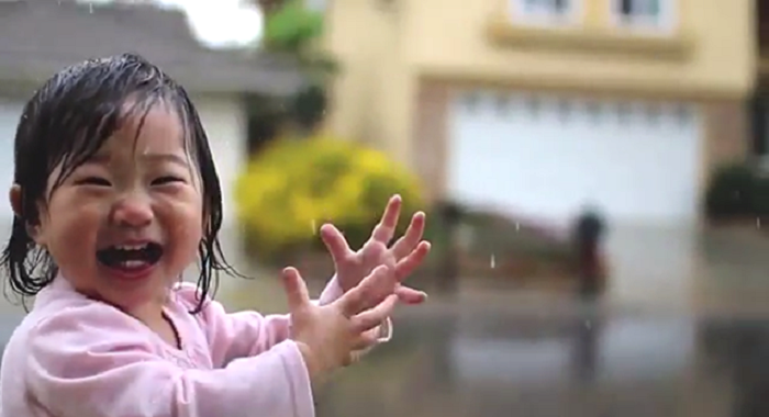 A Little Girl Experiences Rain For The Very First Time
