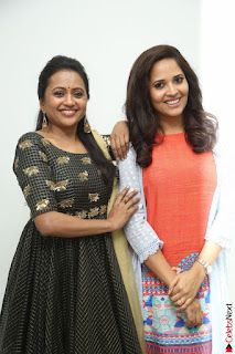 Actress Suma in Black Salwar Suit and Anusuya in orange Dress at winner movie press meet part 1 February 2017 (44).JPG