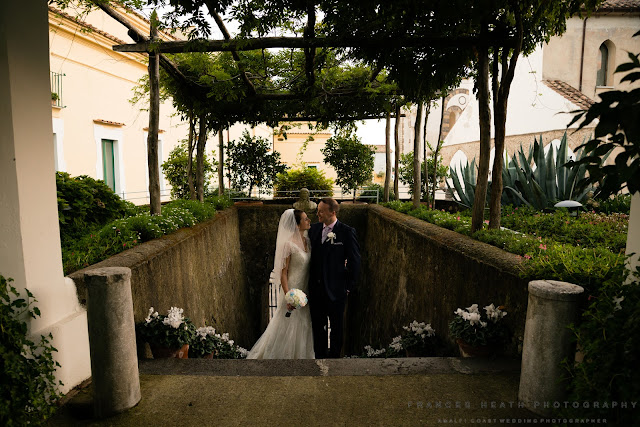 Bride and groom in Caruso Hotel Gardens